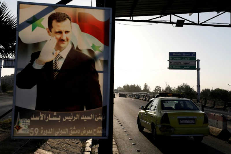 A poster of Bashar Assad along the road in Damascus, Syria, April 14, 2018.