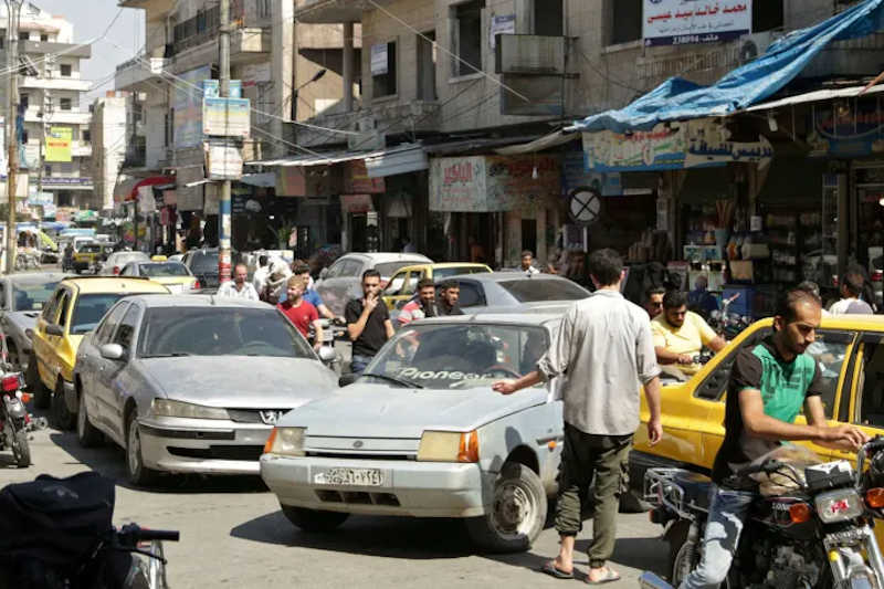 People walk along a crowded street in the city of Idlib, Syria August 3, 2019.