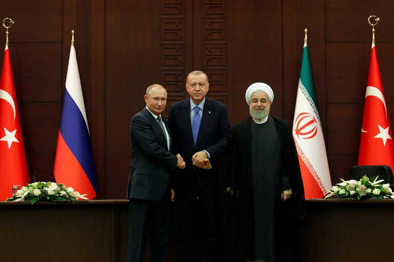 Presidents Vladimir Putin of Russia, Tayyip Erdogan of Turkey and Hassan Rouhani of Iran pose following a joint news conference in Ankara, Turkey, September 16, 2019.