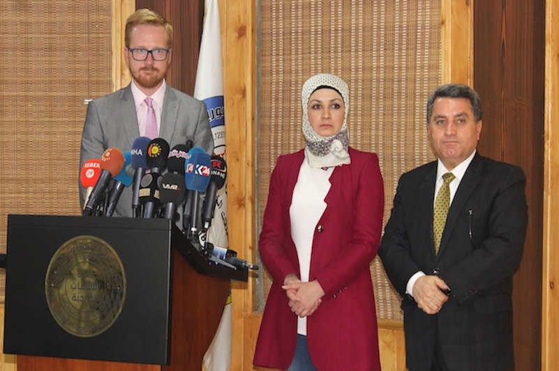 Labour Party MP Lloyd Russell-Moyle addresses the local media in a press conference with officials of the local administration in northeast Syria, Sept. 17, 2019.