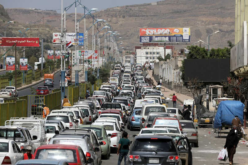 Cars queue at a petrol station during a fuel crisis in Sanaa, Yemen September 25, 2019.
