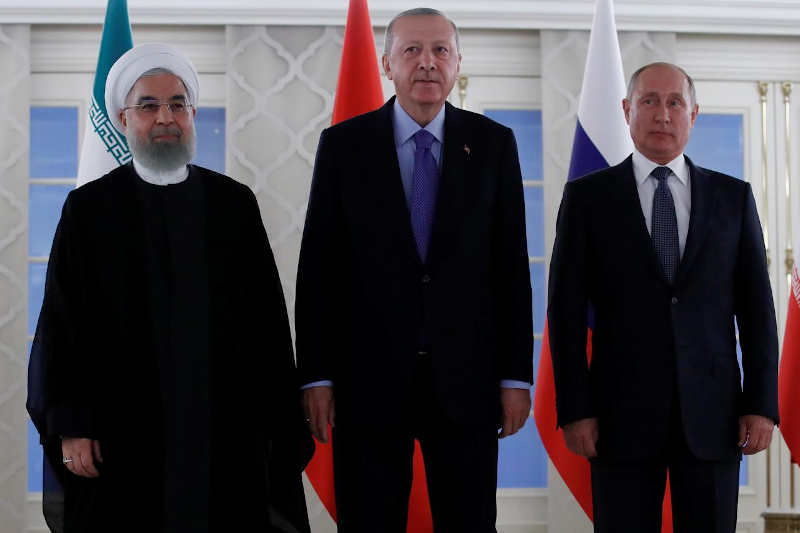 Presidents Hassan Rouhani of Iran, Tayyip Erdogan of Turkey and Vladimir Putin of Russia pose before their meeting in Ankara, Turkey, September 16, 2019.