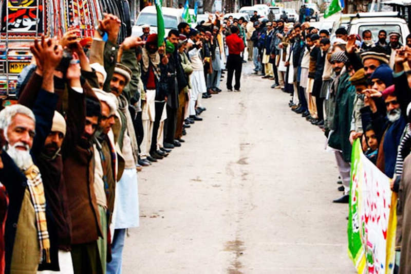 Pakistani citizens make a human chain to express solidarity with the people of India-occupied Kashmir.