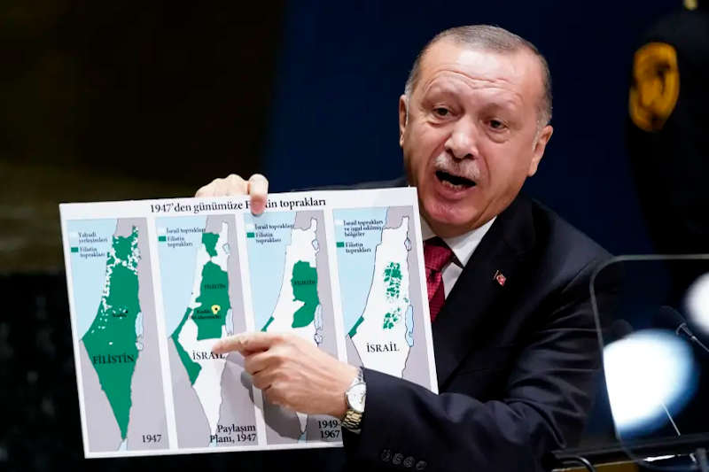 Turkey's President Recep Tayyip Erdogan holds up a map as he addresses the 74th session of the United Nations General Assembly at U.N. headquarters in New York City, New York, U.S., September 24, 2019