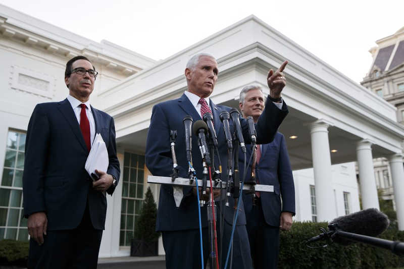 Vice President Mike Pence, with Treasury Secretary Steven Mnuchin, left, and national security adviser Robert O'Brien, speaks to reporters outside the West Wing of the White House, Monday, Oct. 14, 2019, in Washington. The U.S. is calling for an immediate ceasefire in Turkey's strikes against Kurds in Syria, and is sending Pence to lead mediation effort