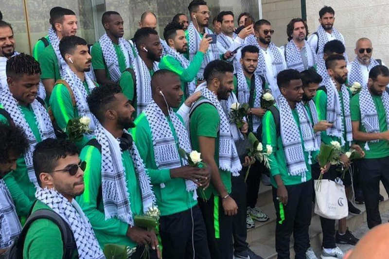 The Saudi Arabian national team arrived in Ramallah on Sunday ahead of their 2022 World Cup qualifying match against Palestine to a heroes' welcome.