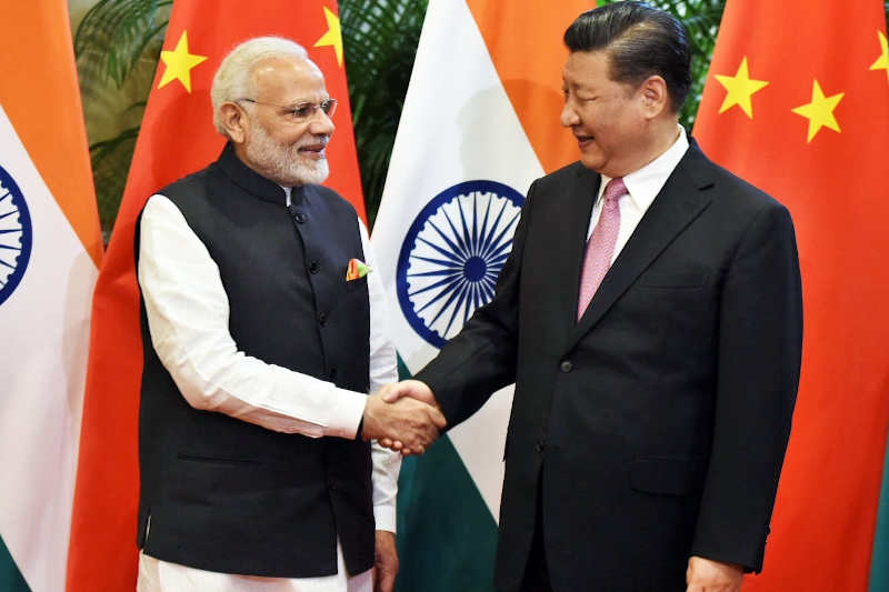 Chinese President Xi Jinping (R) shakes hands with Indian Prime Minister Narendra Modi during their visit at East Lake Guest House, in Wuhan, China, April 27, 2018.