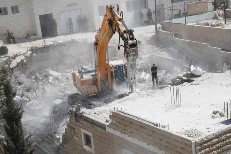 Israeli bulldozers carry out demolitions of Palestinian structures in occupied Jerusalem.