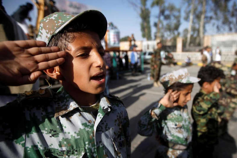 Children take part in a Houthi rally in Sanaa on October 4, 2019.