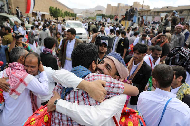 Detainees hug relatives after their release by the Houthis outside the central prison of Sanaa, Yemen September 30, 2019.